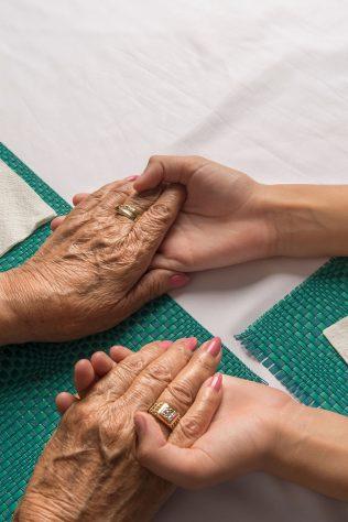 grandmother holding hands