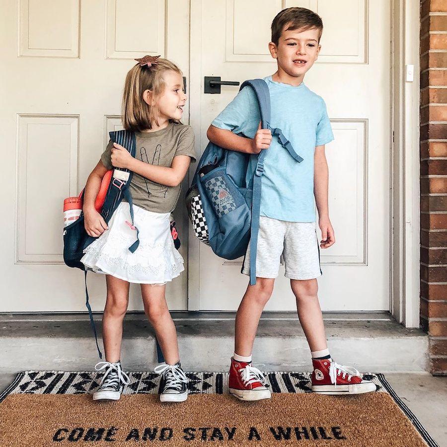 kids wearing backpacks