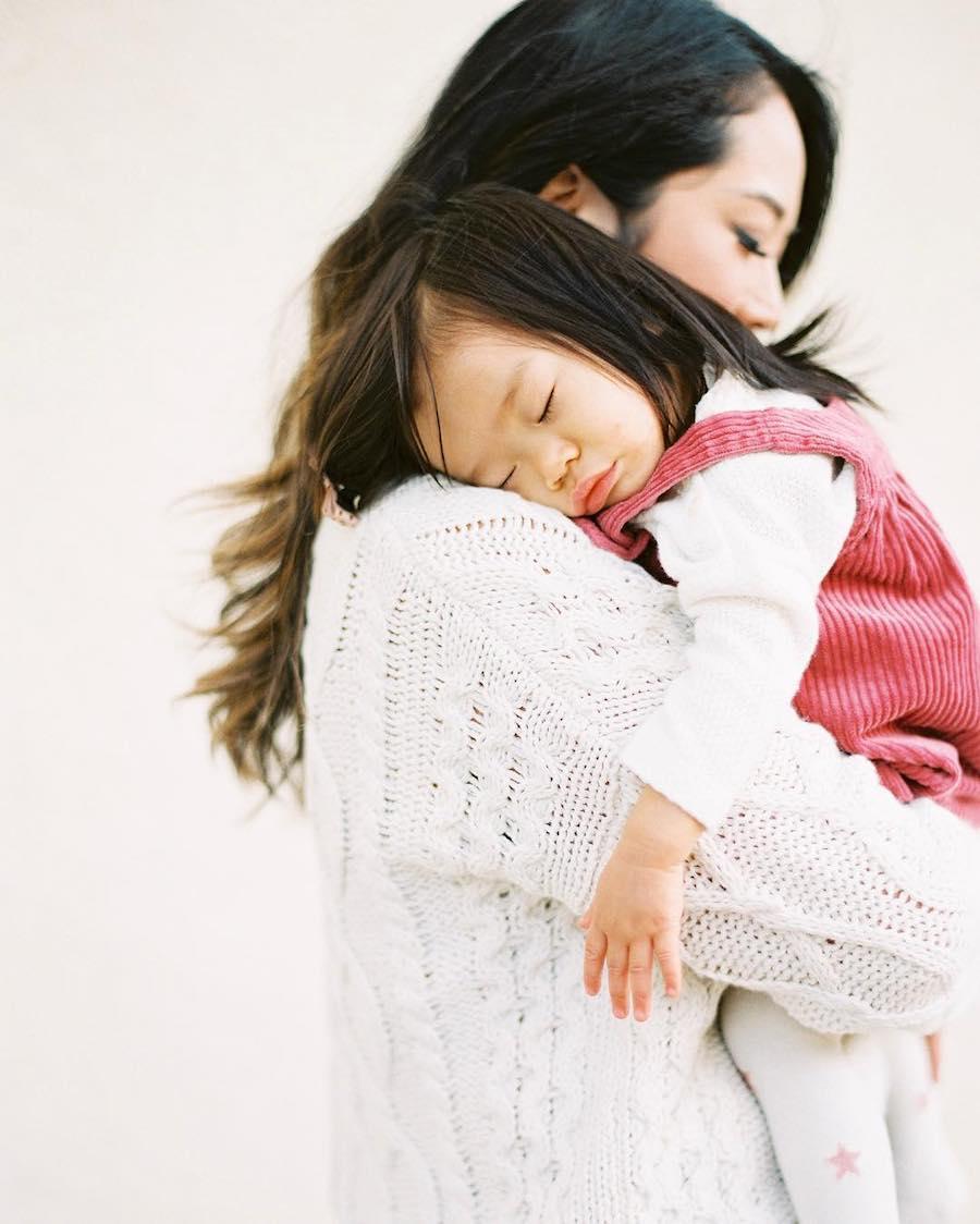 mom holding sleeping child