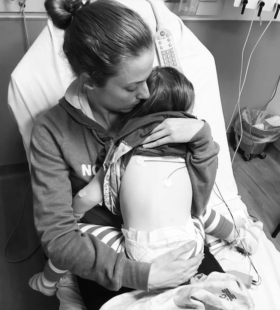 mom holding child in the hospital