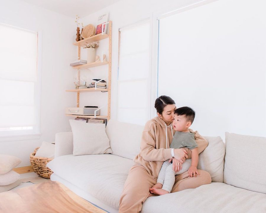 toddler and mom sitting on couch