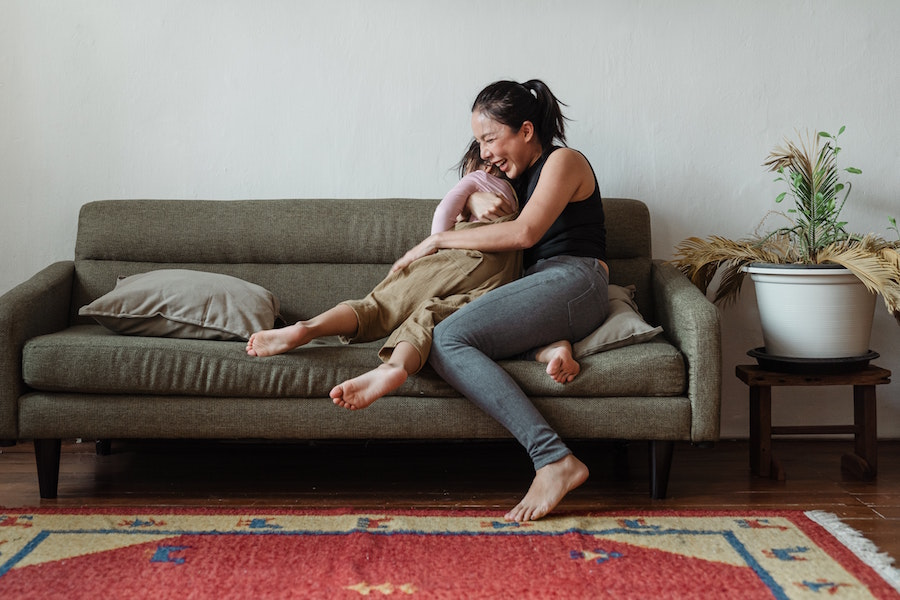 mom hugging child on the couch