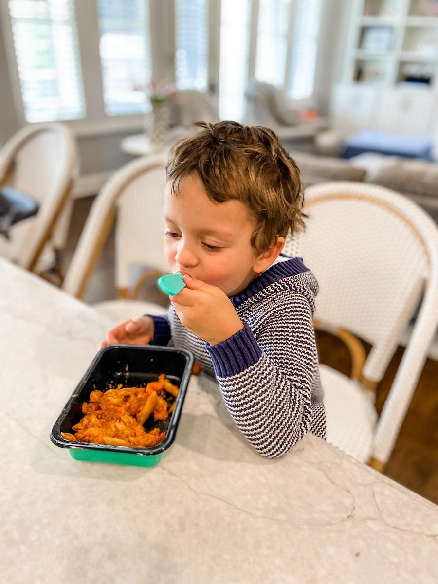 toddler eating dinner