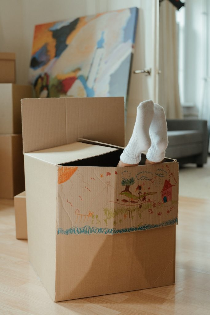 kid playing in box