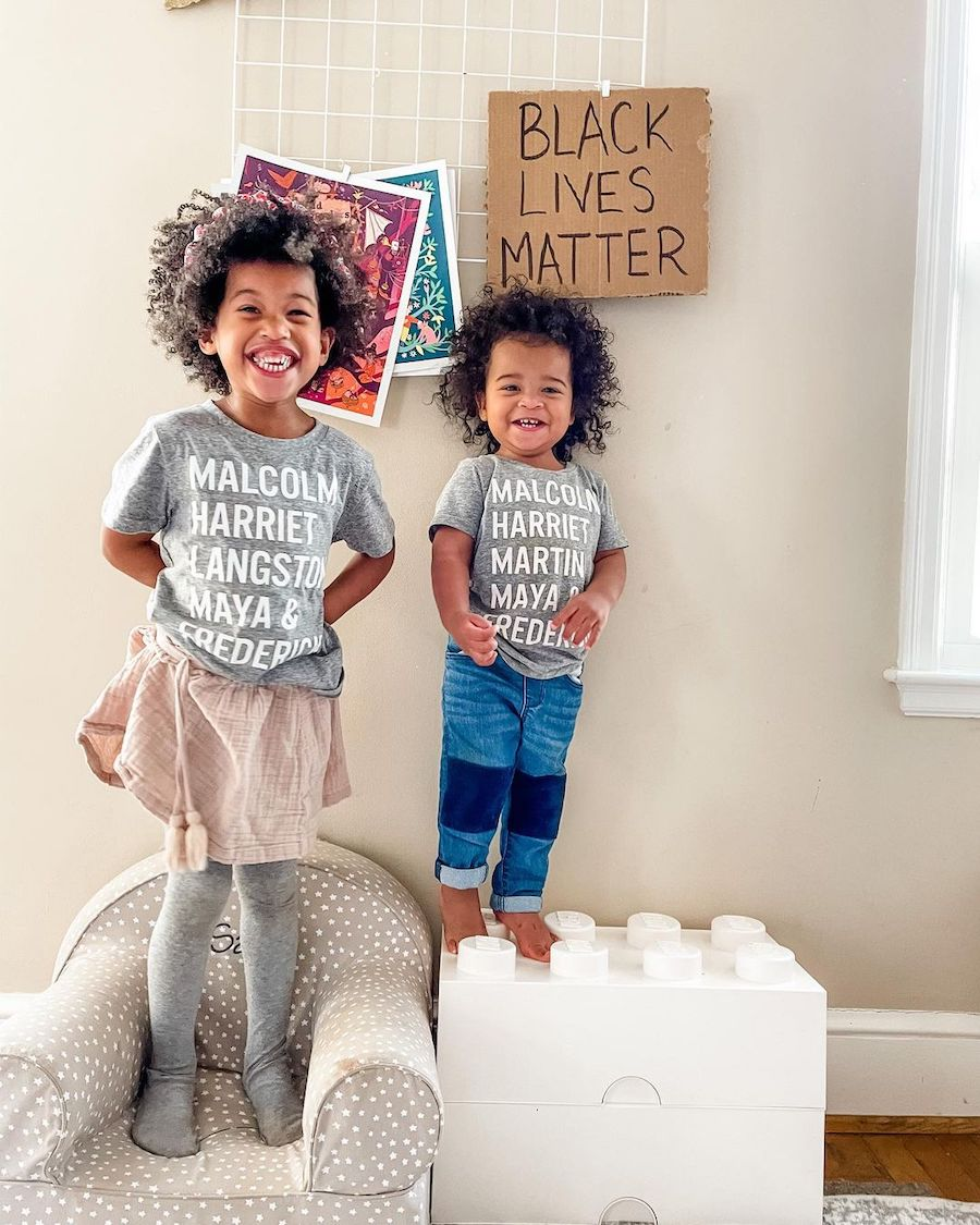 siblings with black lives matter sign