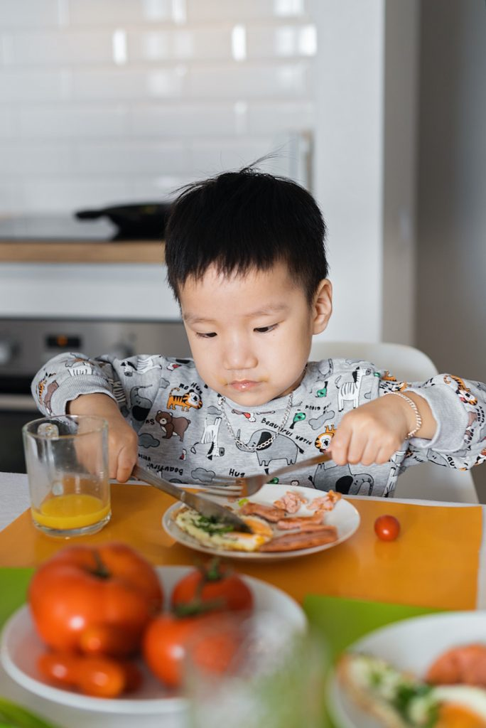 Young boy eating