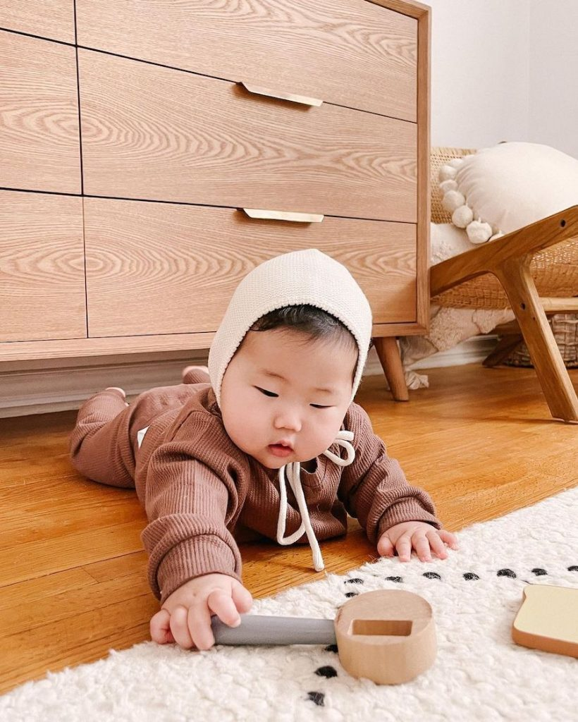 baby playing with montessori toys
