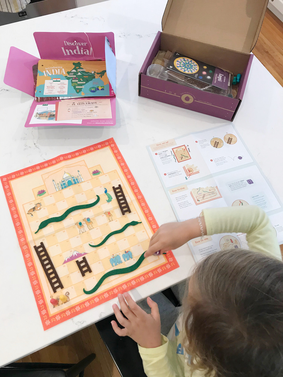 girl playing with kiwico activity crate
