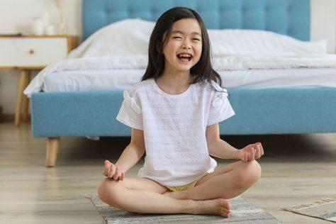 kid doing yoga