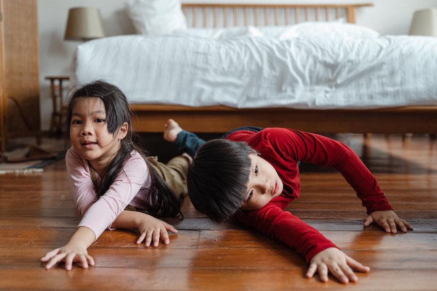 Siblings on floor