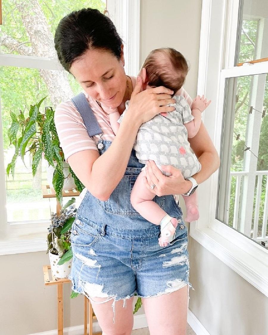mom holding her infant son