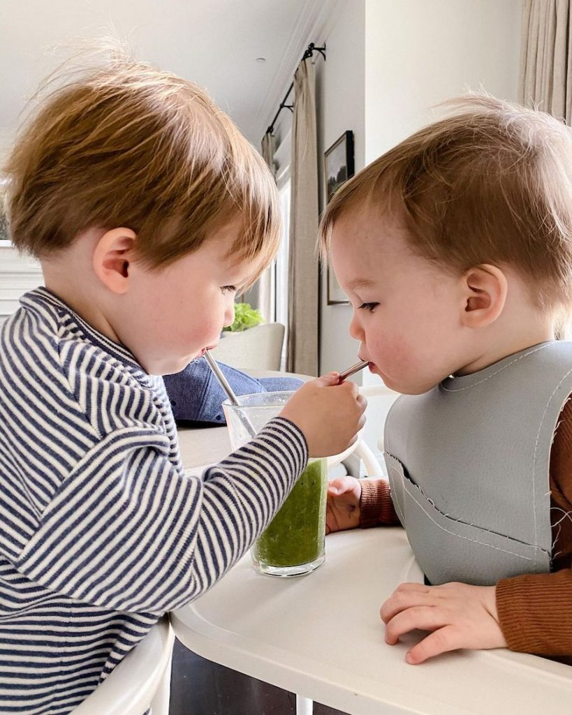 toddlers drinking green juice