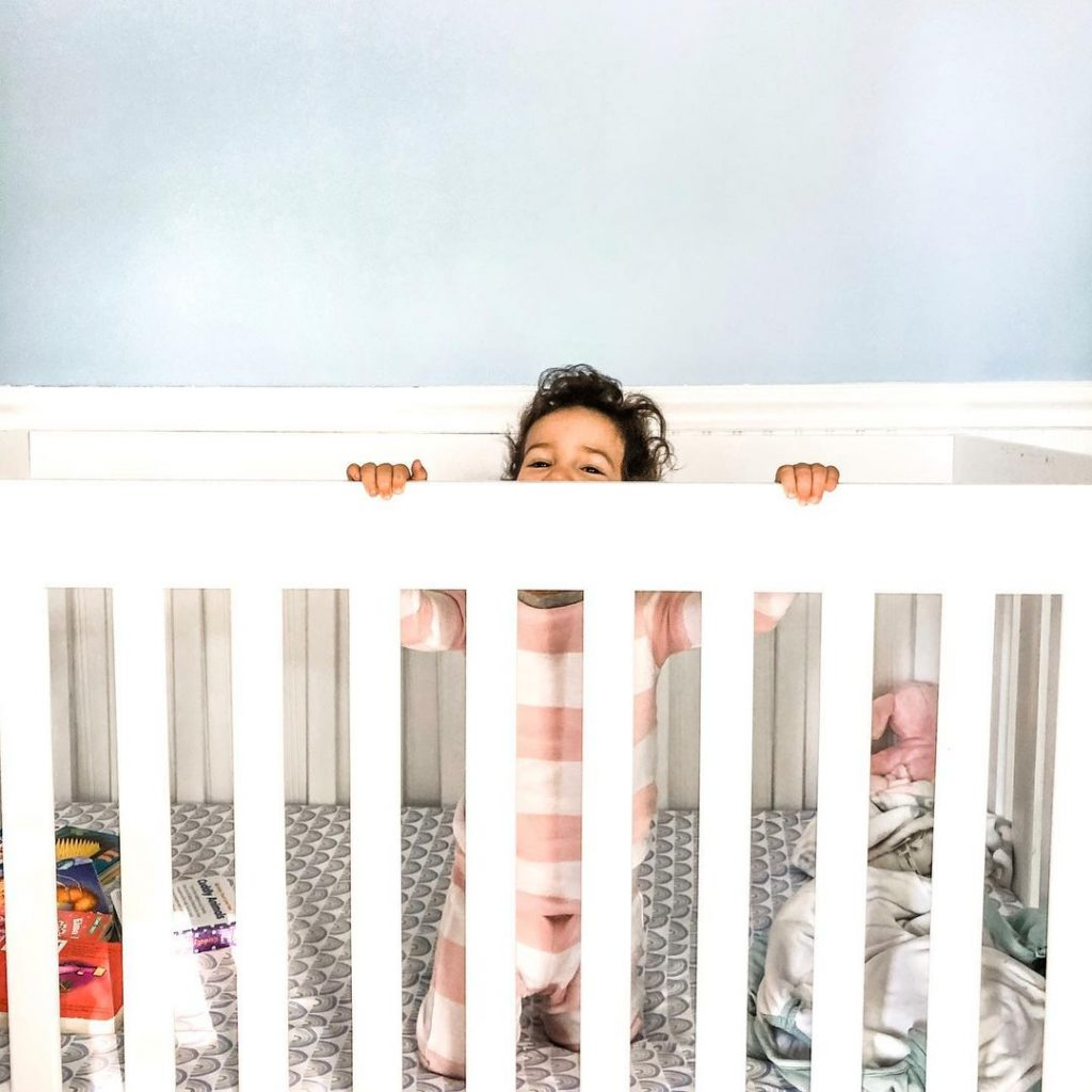 toddler in crib