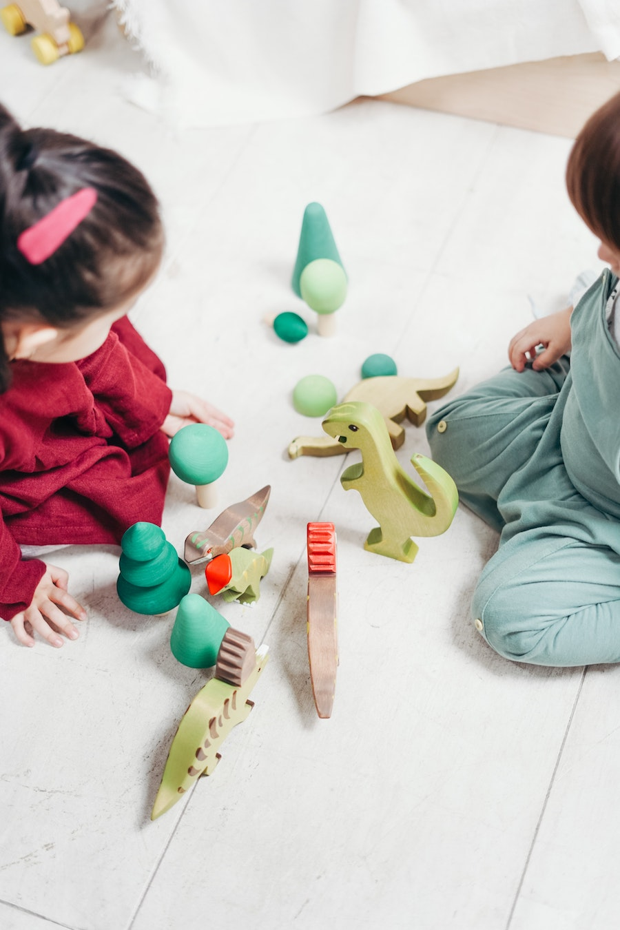 toddlers exploring their bodies