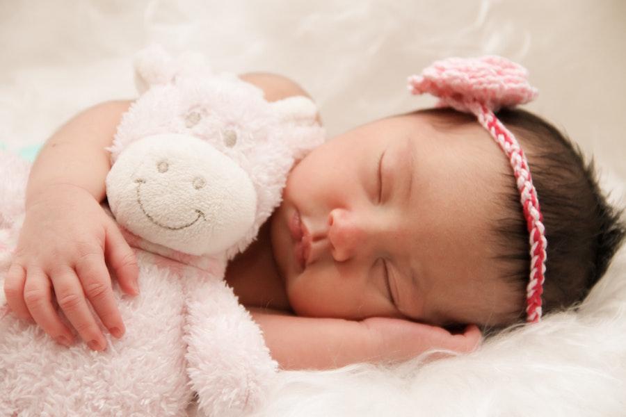 sleeping baby with stuffed animal