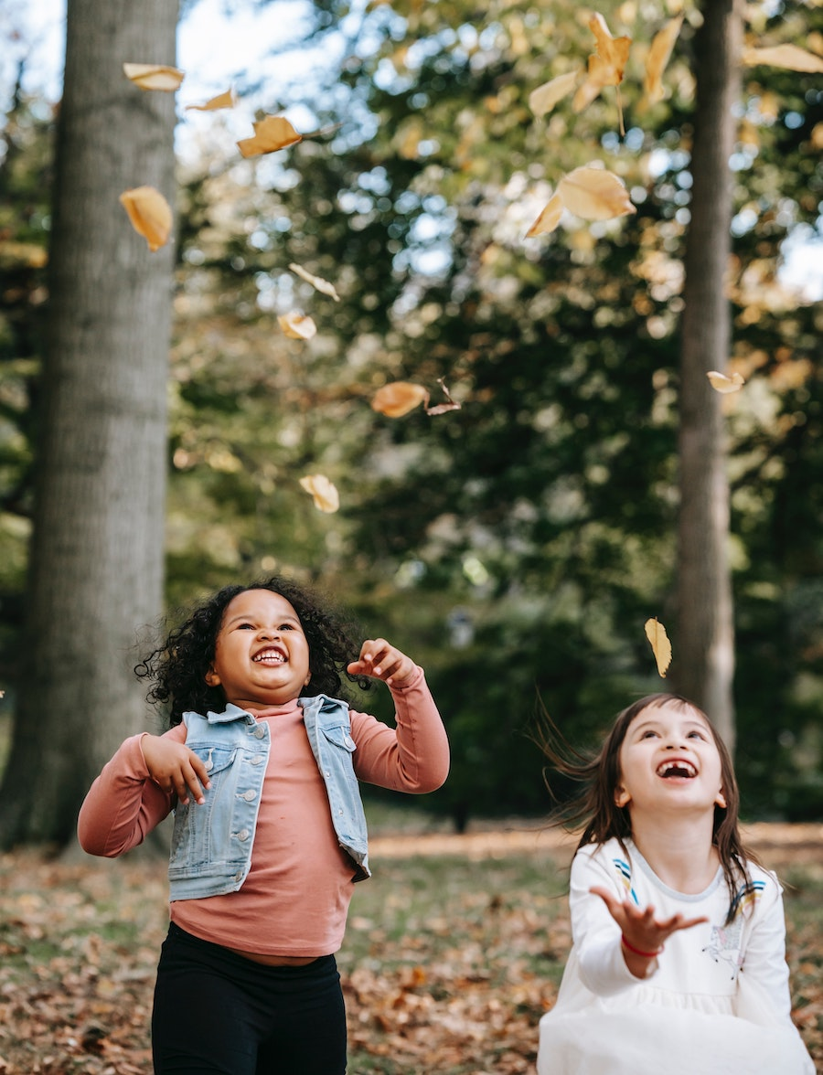 kids tossing leaves